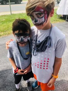 Skulls Face Painting in Kennett Square PA by Jennifer Montgomery of CrazyFaces Face Painting and Body Art Philadelphia 610.764.0853